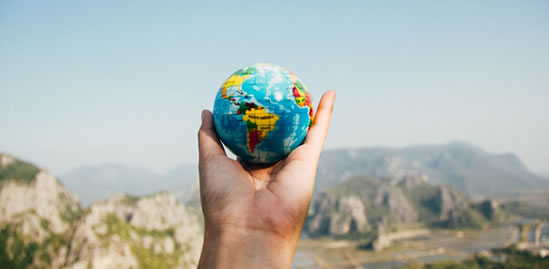 Photo of a hand holding a globe