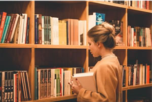 Photo of a girl and a bookshelf